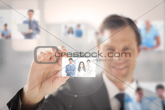 Happy businessman picking a picture
