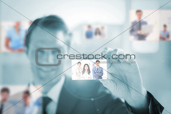 Cheerful businessman picking a picture