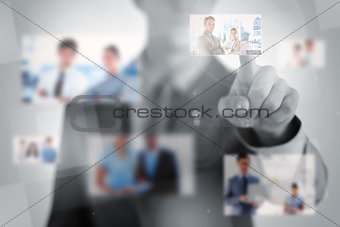 Businessman choosing a picture