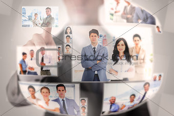 Concentrated businessman selecting a picture
