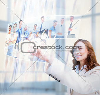 Cheerful businesswoman scrolling pictures