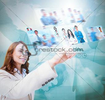 Happy businesswoman scrolling pictures