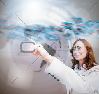 Smiling businesswoman pointing a picture whirl
