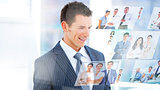 Smiling businessman looking at pictures