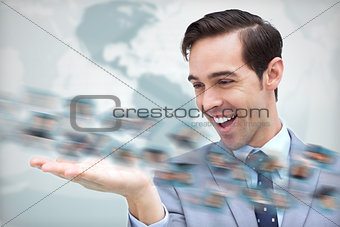 Joyful businessman looking at a picture whirl