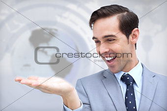 Amazed businessman looking at his hand
