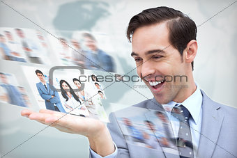 Happy businessman presenting pictures