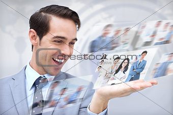 Joyful businessman looking at pictures