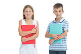 Cheerful brother and sister holding their exercise books