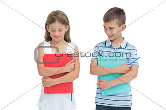 Smiling boy looking at his shy sister