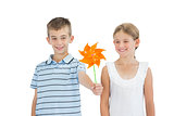 Brother and sister playing with pinwheel