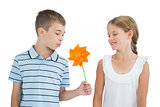 Peaceful brother and sister playing with pinwheel