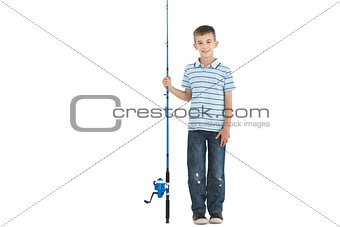 Smiling young boy holding fishing rod