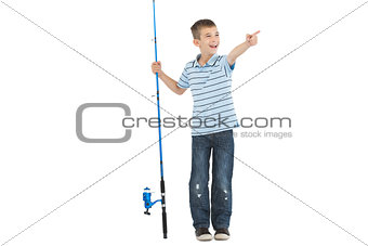 Young boy holding fishing rod pointing
