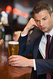 Pensive businessman having a drink