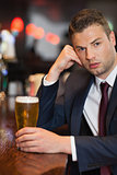 Worried businessman having a drink