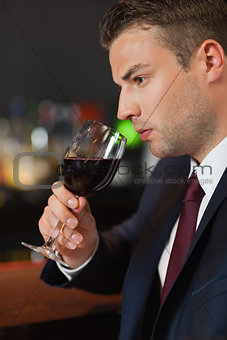 Businessman tasting red wine