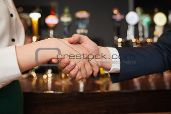 Close up on colleagues shaking hands