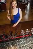 Attractive woman having a flute of champagne