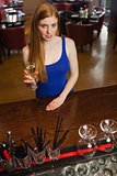 Mysterious attractive woman having a flute of champagne