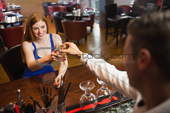 Gorgeous woman being served a flute of champagne