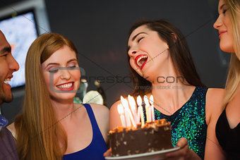 Cheerful friends celebrating birthday together
