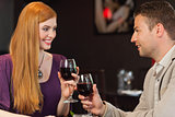 Handsome man having glass of wine with his gorgeous girlfriend