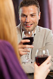 Happy man having glass of wine with his gorgeous girlfriend