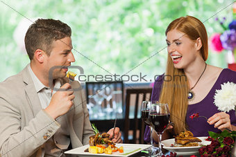 Cheerful couple eating together