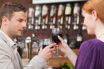 Happy couple having glass of wine together