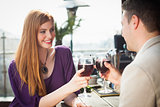 Cheerful couple having glass of wine together