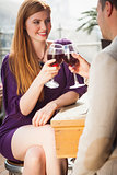 Smiling couple having glass of wine together