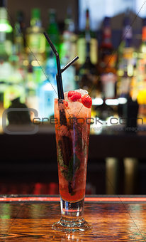 Close up on colourful cocktail with strawberries on the edge
