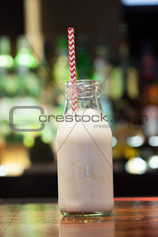 Close up on white russian with funny straw