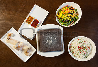 Components of cook it yourself fish dish with hot stone