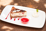 Cheesecake with chantilly cream and coulis