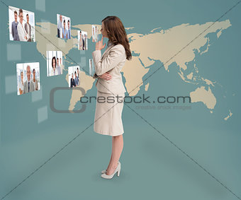 Focused businesswoman looking at digital interface