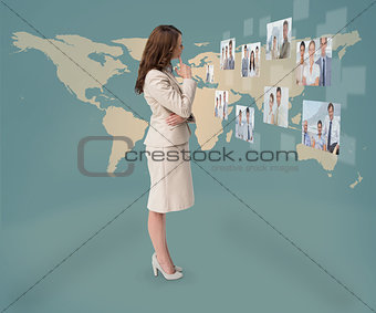 Concentrated businesswoman looking at digital interface