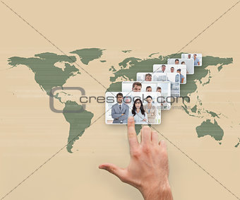 Hand selecting interface showing business people