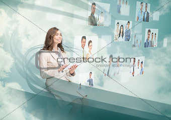Smiling businesswoman using digital interface
