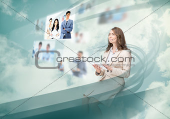 Gorgeous businesswoman using digital interface