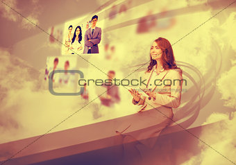 Pretty businesswoman using digital interface