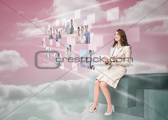 Smiling businesswoman using futuristic interface
