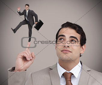 Businessman showing shrunk colleague dancing on his finger