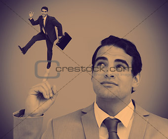 Businessman showing shrunk colleague posing on his finger