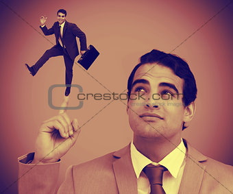 Businessman showing shrunk colleague on his finger