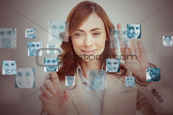Businesswoman touching digital interface