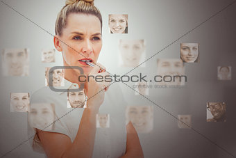 Serious businesswoman encircled by digital interface