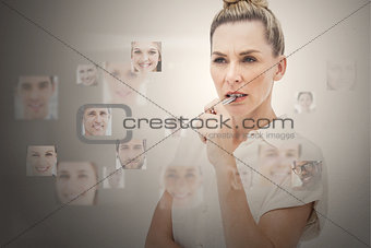 Stern businesswoman encircled by digital interface