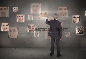 Businessman pointing at digital interface